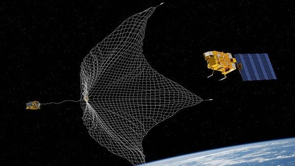 Konzeptgrafik -  Einfangen eines Satelliten mit einem Netz.
