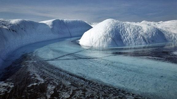 Supraglazialer Bach und Sediment-Aue in Südwest-Grönland