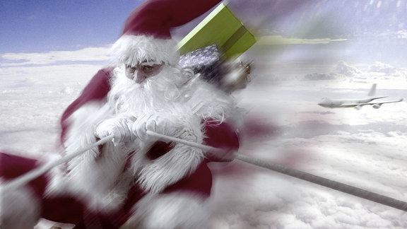 Schneller Weihnachtsmann überholt ein Flugzeug