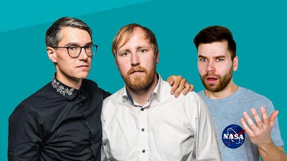 Drei Männer freigestellt vor blauem Hintergrund