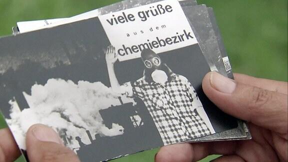 Postkarte in Hand