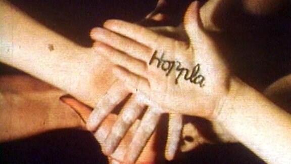 Kinderhände aus Hoppla